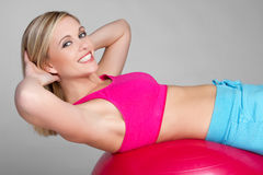 Situps Girl. Young fitness girl doing situps Stock Photo