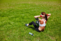 Situps on grass Stock Image