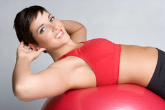 Situps Woman. Young fitness woman doing situps Royalty Free Stock Photography