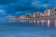 Sity bij the sea. City ​​by the sea , during the blue hour at sunset with clouds dramatich Royalty Free Stock Images