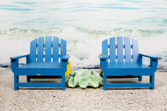 Sitzen auf dem Strand Stockfoto