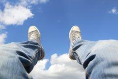 Sitzen im Himmel lizenzfreies stockbild
