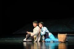 Sitzen Sie auf der Grund-Jiangxi-Oper eine Laufgewichtswaage Stockbild
