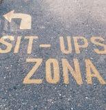 sitzen Sie ups zona Stockfoto