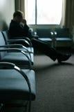 Sitzen und Aufwartung stockfoto