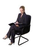 Sitzen und Schreiben Lizenzfreie Stockfotos
