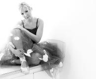 Sitzende Ballerina Stockfoto