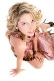 Sitzende blonde Frau Stockfotos