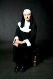 Sitzende Nonne Stockfotografie