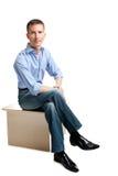 Sitzender stattlicher Kerl Lizenzfreies Stockfoto