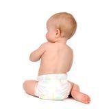 Sitzendes rückwärts gegenüberstellen des Kinderbaby-Kleinkindes von der hinteren Rückseite V Lizenzfreie Stockbilder