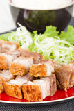 Siu Yuk. Chinese crispy roast pork belly served on top of steamed rice Stock Photography