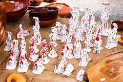 Siurells, typical Majorcan hand painted clay figures with a whistle at Sineu market Royalty Free Stock Photo