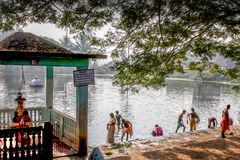 The Devi temple beside the water pond, The Temple and the pond, The Hindu temple and the tank. Siva is here as water element, And Varuna is the God of water, in Royalty Free Stock Photography
