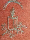 Siver candle. Silver candle on red paper, needlework Royalty Free Stock Images