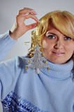 Siver tree. Blond lady with silver christmas tree Stock Image