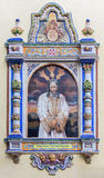 Siviglia - Cristo piastrellato nel legame vicino da 20 centesimo sulla facciata della chiesa Iglesia San Juan de la Palma Immagini Stock Libere da Diritti