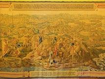 Siviglia - il gobelin con la guerra tunisina durante l'anno 1535 in palazzo gotico in alcazar di Siviglia dall'autore anonimo Fotografia Stock