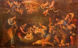 Siviglia - l'adorazione della pittura dei pastori in chiesa Iglesia de la Annunciation dal pittore sconosciuto Immagine Stock Libera da Diritti