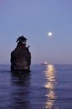 Siwash rock at moonset Stock Photo