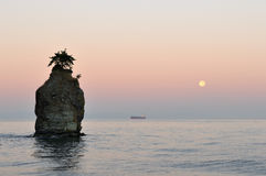 Siwash rock at moonset Royalty Free Stock Photography