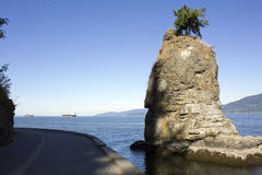 Siwash Rock, Stanley Park. Stanley Parks famous Siwash Rock looking west onto English Bay Royalty Free Stock Photo