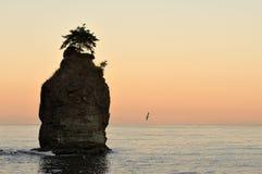 Siwash rock at sunrise Stock Photo