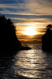 Siwash Rock Sunset. Sun setting behind Siwash Rock. Stanley Park, Vancouver, BC, Canada Stock Photo