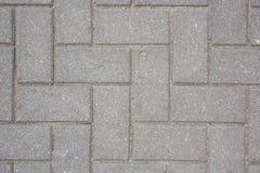 Siwieje betonową płytkę na zmielonym bruk ścieżki abstrakta wzoru tekstury tle Obraz Royalty Free