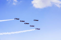 Six aircraft doing airshow in the blue sky Stock Photography