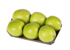 Six apples. Six green apples on a cardboard isolated on white Royalty Free Stock Photos