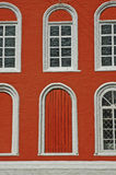 Six arc windows. On a red bricked wall stock photo