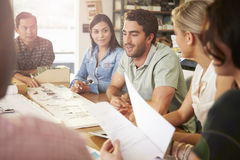Six Architects Sitting Around Table Having Meeting stock photography