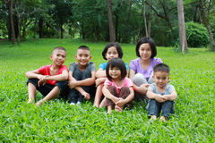 Six asian kids having a good time in the park. Stock Images