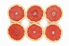 Six beautiful tasty red grapefruit isolated on white Stock Photography
