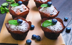 Six berry muffins with berries blueberry Royalty Free Stock Image