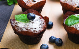 Six berry muffins with berries blueberry Stock Photography