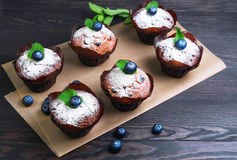 Six berry muffins with berries blueberry Royalty Free Stock Photos