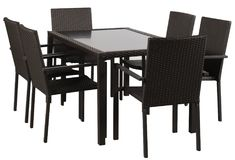Six black rattan chairs and a black rattan dining table on a white background royalty free stock image