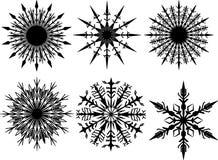 Six black silhouette snowflakes Stock Image