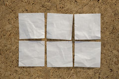 Six blank white reminder notes on cork board Royalty Free Stock Photo