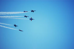 Six Blue Angels Airplanes Perform as a Team. Six Blue Angels airplanes perform together in unison as a team at an air and water show Royalty Free Stock Photography