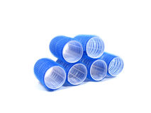 Six blue hair curlers over white background Royalty Free Stock Photo