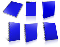 Six blue spiral blank notepad on white. Royalty Free Stock Photo