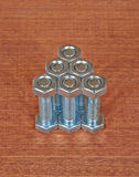 Six bolts with nuts Stock Photo