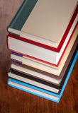 Six books stacked neatly on a table Stock Photos
