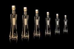 Six bottle. In black backround Royalty Free Stock Photography