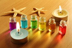 Six bottles with aroma oils, candles and starfish Royalty Free Stock Photography