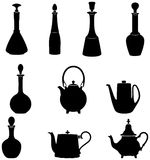 Six bottles Four teapots Stock Images