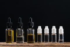 Six bottles of liquids are arranged in the form of a background on the table Royalty Free Stock Photography